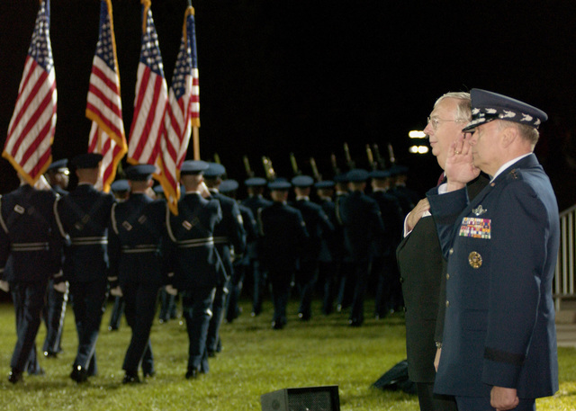 The Honorable Secretary of the Air Force Dr. James G. Roche, and CHIEF of STAFF of the Air Force GEN. John P. Jumper observe a pass and review of the U.S. Air Force Honor Guard Drill Team during the United States Air Force Tattoo Ceremony at Bolling Air Force Base, Washington D.C., on Oct.  5, 2004. (U.S. Air Force PHOTO by STAFF SGT. Amber K. Whittington) (RELEASED)