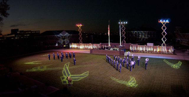 The U.S. Air Force Honor Guard Drill Team (left) and the U.S. Air Force Band (right) stand at attention on the ceremonial lawn as they perform during the U.S. Air Force Tattoo Ceremony, hosted by the Honorable Dr. James G. Roche, Secretary of the Air Force, and U.S. Air Force GEN. John P. Jumper, CHIEF of STAFF of the Air Force, on Oct. 5, 2004, at Bolling Air Force Base, District of Columbia. (US Air Force photo by STAFF SGT. Amber K. Whittington) (Released)