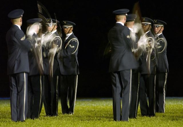 The U.S. Air Force Honor Guard Drill Team perform a routine during the United States Air Force Tattoo Ceremony at Bolling Air Force Base, Washington D.C., on Oct.  5, 2004.  (U.S. Air Force PHOTO by STAFF SGT. Amber K. Whittington) (RELEASED)