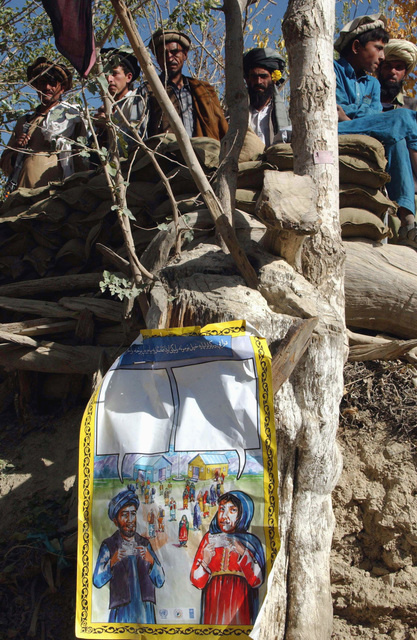 A sign informing Afghani locals where and how they can vote hangs from a tree in the Gayan District of Afghanistan. US Army (USA) Soldiers and Afghanistan National Army (ANA) provided support and security for national elections, during Operation ENDURING FREEDOM