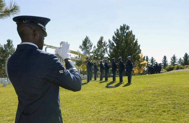 A Buckley Air Force Base Honor Guard bugler plays taps at the funeral for World War II flying ace, retired COL. John Smith Stewart at the Ft. Logan National Cemetery, Denver, Colo., on Oct. 8. 2004. (U.S. Air Force PHOTO by STAFF SGT. Anika Williams) (RELEASED)