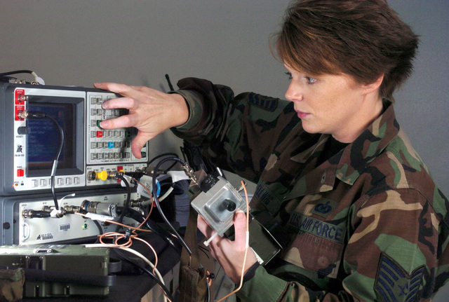 U.S. Air Force 17th Special Operations Squadon life support technician TECH. SGT. Jennifer Hellwig, inspects a PRC-112B1 survival equipment radio at Kadena Air Base, Japan, on Oct. 8, 2004.  (U.S. Air Force PHOTO by MASTER SGT. Val Gempis) (RELEASED)