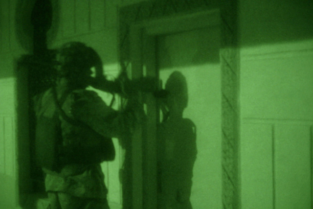 An Iraqi Soldier, Iraqi Counter Terrorism Force (ICTF) attached to the US Marine Corps (USMC) 2nd Squad, 1ST Platoon (PLT), Golf Company (G Co.), 2nd Battalion (BTN), 5th Marine Regiment, 1ST Marine Division (MARDIV), uses his rifle to break a padlock in order to enter a locked room during a raid of the Al Haq Mosque in order to search for illegal weapon caches and propaganda while involved in a Security and Stabilization Operation (SASO) in Ar Ramadi, Al Anbar Province, Iraq, during Operation IRAQI FREEDOM. (SUBSTANDARD)