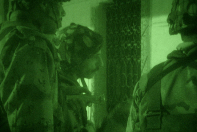 Iraqi Soldiers, Iraqi Counter Terrorism Force (ICTF) attached to the US Marine Corps (USMC) 2nd Squad, 1ST Platoon (PLT), Golf Company (G Co.), 2nd Battalion (BTN), 5th Marine Regiment, 1ST Marine Division (MARDIV), prepare to break a padlock in order to enter a locked room during a raid of the Al Haq Mosque in order to search for illegal weapon caches and propaganda while involved in a Security and Stabilization Operation (SASO) in Ar Ramadi, Al Anbar Province, Iraq, during Operation IRAQI FREEDOM. (SUBSTANDARD)