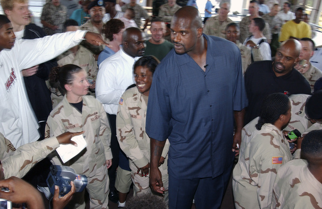 National Basketball Association star Shaquille O'Neill (blue pant suit) of the Miami Heat meets with U.S. Army Soldiers, Headquarters, United States Central Command (CENTCOM), while visiting MacDill Air Force Base, Fla., Oct. 14, 2004.  (U.S. Air Force photo by STAFF SGT. Chad Chisholm) (Released)