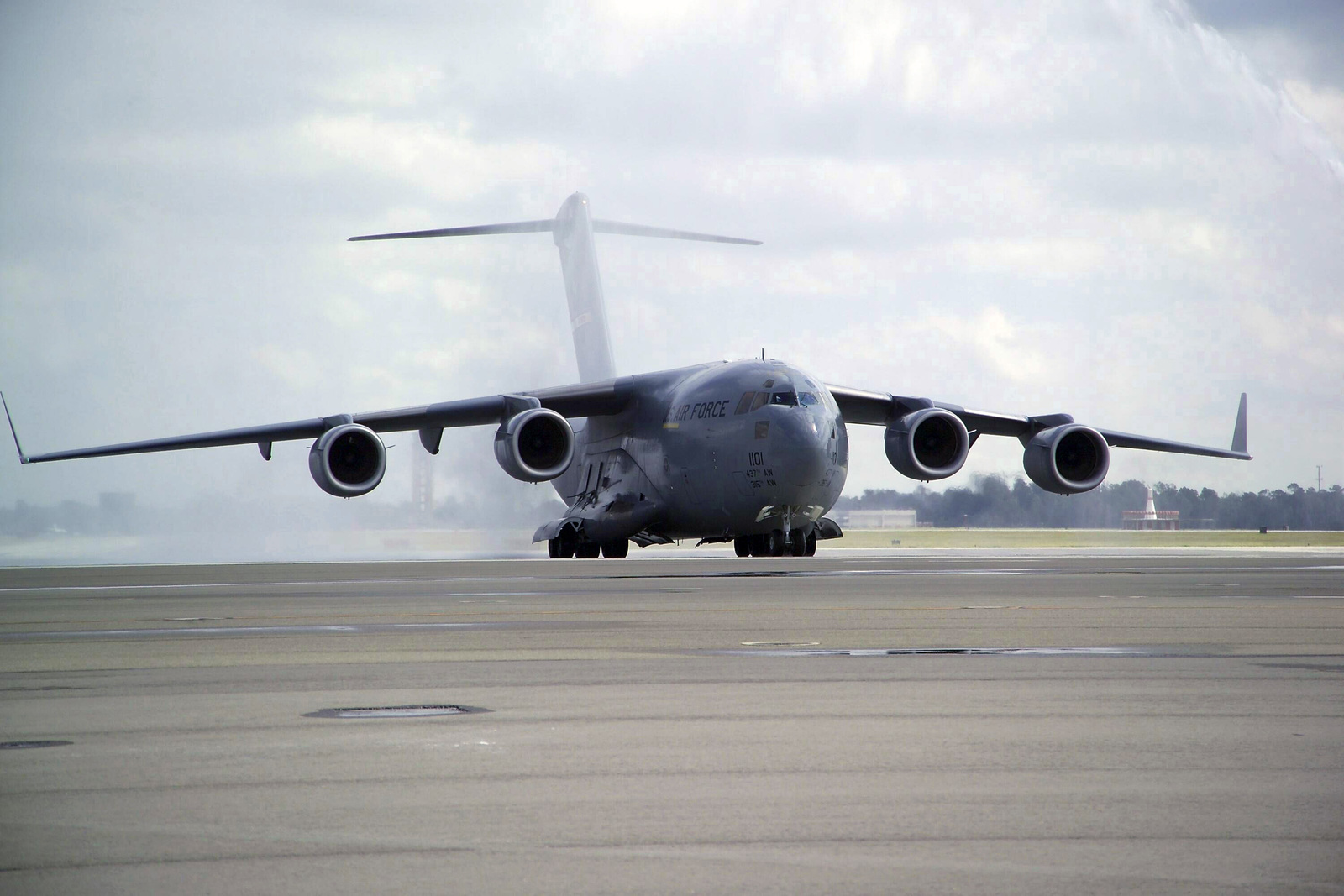 U.S. Air Force C-17 Globemaster III aircraft, 437th Airlift Wing (AW), Charleston Air Force Base, S.C., piloted by Brig. GEN. (select) Brooks Bash, Commander, 437th AW, taxis in from the landing strip on Oct. 15, 2004.  General Bash is performing his last flight, also known as a'fini-flight,'as the commander of the airlift wing.'Fini-flights'are a time-honored custom in the Air Force.  Most often, the pilot is'hosed down'by his/her peers just after the final flight. (U.S. Air Force photo by TECH. SGT. Richard T. Kaminsky) (Released)