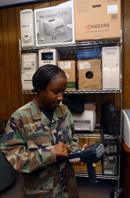 U.S. Air Force SENIOR AIRMAN Kristin M. Sobers, Systems Manager, 436th Logistics Readiness Squadron, configures a handheld terminal at Dover Air Force Base, Del., on Oct. 18, 2004. (U.S. Air Force photo by Jason N. Minto) (Released)