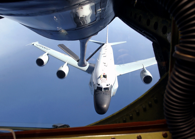 A boom on a U.S. Air Force KC-135 Stratotanker refueler aircraft with the 19th Air Refueling Group, 99th Air Refueling Squadron, Robins AFB, Ga., is being guided to refuel an RC-135 reconnaissance aircraft from Offut AFB, Neb., on Oct. 20, 2004.(U.S. Air Force PHOTO by AIRMAN Bradley A. Lail) (RELEASED)