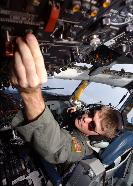 U.S. Air Force 1ST LT. Greg Somborn, Co-Pilot, 19th Air Refueling Group, 99th Air Refueling Squadron, Offut AFB, Neb., is checking an instrument gauge on a KC-135 Stratotanker refueler aircraft, on Oct. 20, 2004.(U.S. Air Force PHOTO by AIRMAN Bradley A. Lail) (RELEASED)