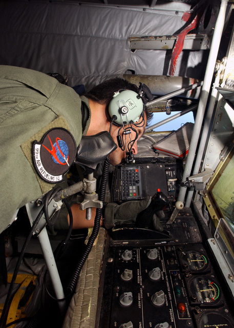 U.S. Air Force STAFF SGT. Denim Beeler, Boom Operator, 19th Air Refueling Group, 99th Air Refueling Squadron, Robins AFB, Ga., is preparing for a refueling mission in a KC-135 Stratotanker refueler aircraft, on Oct. 20, 2004.(U.S. Air Force PHOTO by AIRMAN Bradley A. Lail) (RELEASED)