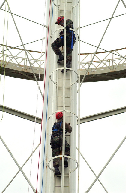 U..S. Air Force SENIOR AIRMAN Gary Jones (top) and STAFF SGT. Jason Ramirez, ascend the McChord AFB , Wash. water tower during a simulated rescue scenario, on Oct. 21, 2004.(U.S. Air Force PHOTO by Kristin Royalty, CIV.) (RELEASED)