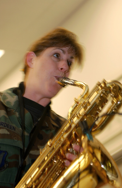 A U.S. Air Force AIRMAN with the Band of the Pacific, Greatlanders show band, plays a saxophone during Red Ribbon Week at Ursa Minor Elementary school at Ft. Richardson, Alaska on Oct. 22, 2004.(U.S. Air Force PHOTO by AIRMAN 1ST Class Garrett E. Hothan) (RELEASED)