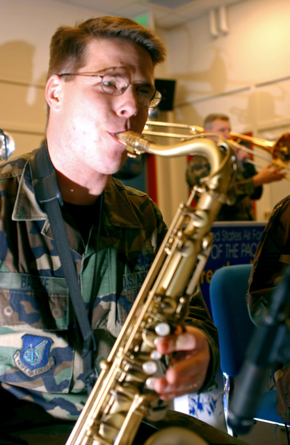 U.S. Air Force STAFF SGT. Jason Baedke, Band of the Pacific, Greatlanders show band, playing a saxophone during Red Ribbon Week at Ursa Minor Elementary school at Ft. Richardson, Alaska on Oct. 22, 2004.(U.S. Air Force PHOTO by AIRMAN 1ST Class Garrett E. Hothan) (RELEASED)