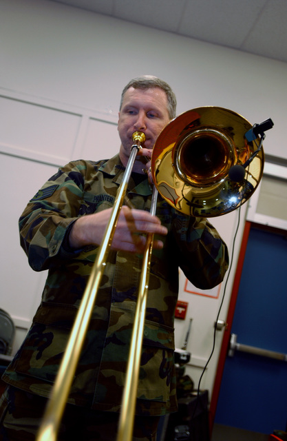 U.S. Air Force STAFF SGT. John Pranter, Band of the Pacific, Greatlanders show band, plays a trombone during Red Ribbon Week at Ursa Minor Elementary school at Ft. Richardson, Alaska on Oct. 22, 2004.(U.S. Air Force PHOTO by AIRMAN 1ST Class Garrett E. Hothan) (RELEASED)