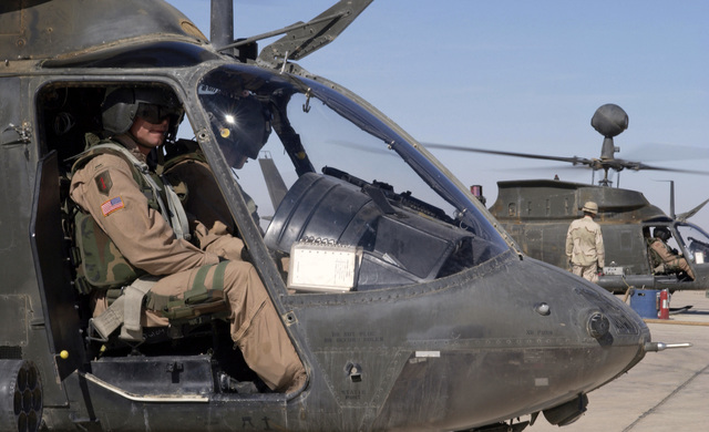 U.S. Army CHIEF Warrant Officer Frank Reis, Delta Troop, 1-4 Cavalry, 1ST Infantry Division, waiting for fuel in an OH-58D Kiowa Warrior helicopter, at Forward Operating Base McKenzie, Iraq, on Oct. 23, 2004, in support of Operation IRAQI FREEDOM.(U.S. Air Force PHOTO by STAFF SGT. Shane A. Cuomo) (RELEASED)