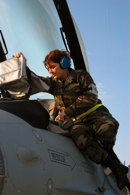 U.S. Air Force SENIOR AIRMAN Sarah Spy preflights an F-16C Fighting Falcon fighter aircraft, from the 180th Fighter Wing, Ohio Air National Guard during a Red Flag 05-01 exercise at Nellis Air Force Base, Nev., on Oct. 25, 2004