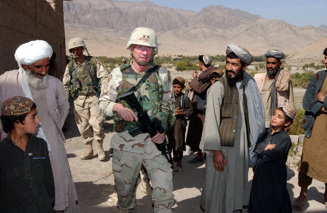During Operation Outlaw, US Army (USA) Major General (MGEN) Eric T. Olson, Commander, Combined Joint Task Force 76 (CJTF-76), talks with local village elders, while on patrol with USA Soldiers assigned to 2nd Battalion, 5th Infantry Regiment, in the Cehar Cineh area of Afghanistan, during Operation ENDURING FREEDOM