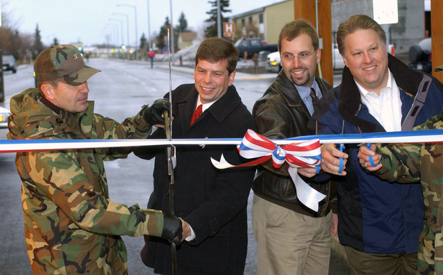 U.S. Air Force COL. Michael A. Snodgrass, left, 3rd Wing Commander, Anchorage Mayor Mark Begich, 2nd right, and other personnel during a ribbon cutting ceremony for the re-opening of the Government Hill gate at Elmendork Air Force Base, Alaska, on Oct 26, 2004.(U.S. Air Force PHOTO by AIRMAN De-Juan Haley) (RELEASED)