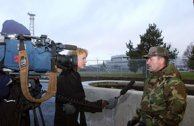 U.S. Air Force COL. Michael Snodgrass, Commander of the 3rd Wing, Elmendorf Air Force Base, Alaska, is interviewed by Alaska News Channel 2 about the reopening of the Government Hill Gate at Elmendorf AFB, on Oct. 26, 2004. (USAF PHOTO by STAFF SGT. Prentice Colter) (Released)