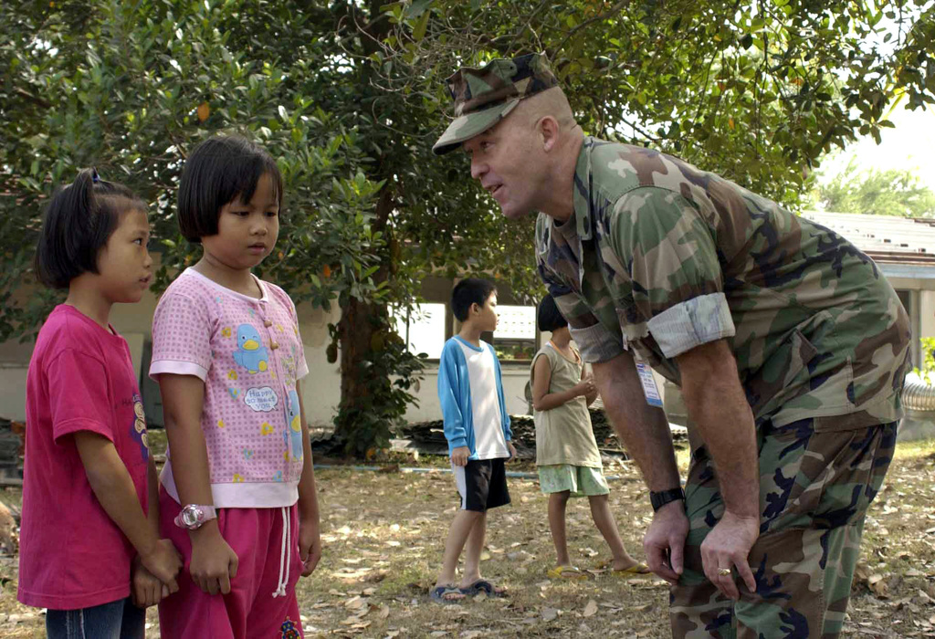 US Marine Corps (USMC) Sergeant Major (SGM) O'Donnell, assigned to Marine Aircraft Group One Two (MAG-12), speaks English with two Thai Students from the St Mary's Catholic School, at Royal Thai Air Force Base (RTAFB) Korat, Thailand, during a visit conducted during the Thailand Incremental Training Program-Aviation (TITP-A) 2004, at Royal Thai Air Force Base (RTAFB) Korat, Thailand. TITP-A is a MAG-12 deployment to conduct air-to-ground core competency training and combined training with Royal Thai Air Force (RTAF) units