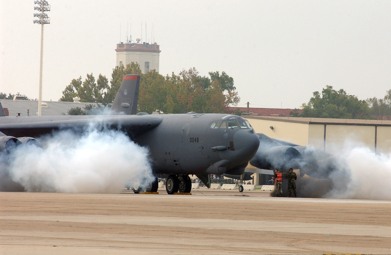 A U.S. Air Force B-52H Stratofortress aircraft from the 2nd Bomb Wing is enveloped in smoke as a starter cartridge starts its engines during an Operation Readiness Exercise at Barksdale Air Force Base, La., on Oct. 29, 2004. (USAF PHOTO by AIRMAN 1ST Class Trina Flannagan) (Released)