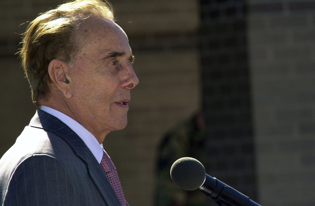 Former U.S. Senator Robert J. Dole gives a speech during the dedication ceremony of the Robert J. Dole Community Center at McConnell Air Force Base, Kan., on Oct. 29, 2004. Sen. Dole was honored for his contributions toward rebuilding McConnell AFB after the base was damaged by a tornado in the spring of 1991. (USAF PHOTO by TECH. SGT. Michael Boquette) (Released)