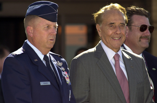 U.S. Air Force COL. David J. Kramer (left), 22nd Air Refueling Wing Vice Commander, and former U.S. Senator Robert J. Dole attend the dedication ceremony of the Robert J. Dole Community Center at McConnell Air Force Base, Kan., on Oct. 29, 2004. Sen. Dole was honored for his contributions toward rebuilding McConnell AFB after the base was damaged by a tornado in the spring of 1991. (USAF PHOTO by TECH. SGT. Michael Boquette) (Released)