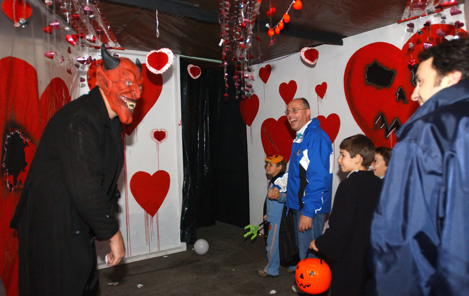 Community members get together to celebrate Halloween with their friends and family at the Haunted House at Aviano AB, Italy, on Oct. 30, 2004. Volunteers from the base helped build a Haunted House that consists of different themes for each room. (USAF PHOTO by AIRMAN 1ST Class Desiree Hayden) (Released)