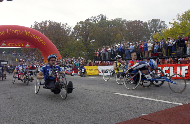 Participants in the wheelchair/ hand-crank race start off the 29th Annual Marine Corps Marathon (MCM) at Washington, D.C., on Oct. 31, 2004. Since its inception in 1976, over 293,000 civilian and military runners from all walks of life have participated in the MCM. (USAF PHOTO by STAFF SGT. Gina M. OBryan) (Released)