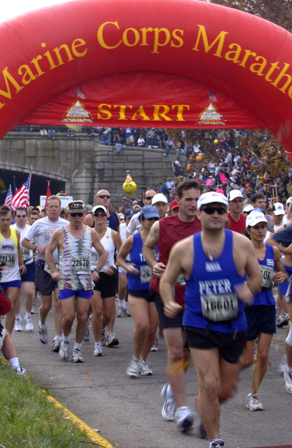 Runners take off at the starting line of the 29th Annual Marine Corps Marathon (MCM) at Washington, D.C., on Oct. 31, 2004. The 18,000 MCM participants, ranging in age from 14 to 83, assembled in a straight line down Route 110, taking up an estimated three-quarters of a mile. (USAF PHOTO by STAFF SGT. Gina M. OBryan) (Released)