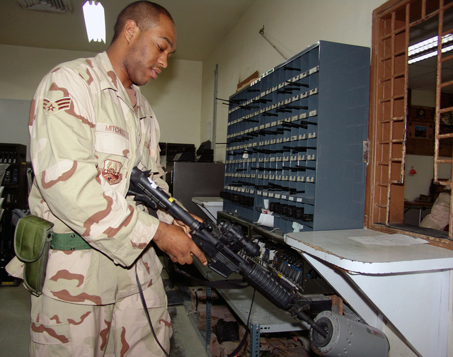 U.S. Air Force SENIOR AIRMAN Cain Mitchell, a member of the 386th Expeditionary Security Forces Squadron, clears an 5.56 mm M4 carbine rifle at an armory at a forward deployed location during Operation Iraqi Freedom on Nov. 1, 2004. (USAF PHOTO by CAPT Aaron Burgstein) (Released)