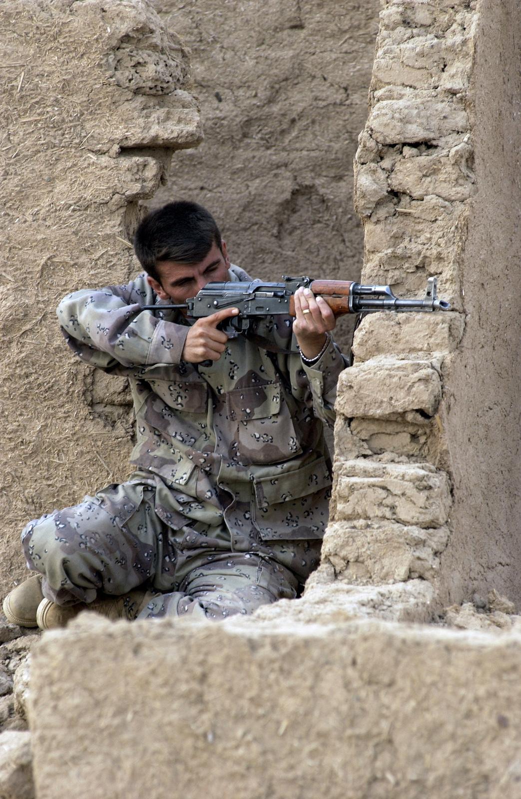 A member of the Iraqi National Guard aims his 7 62 mm Tabuk