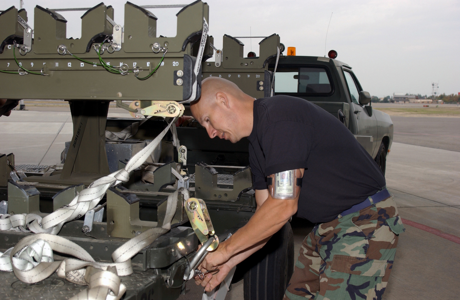 California Air National Guard STAFF SGT. Charlie Archuleta, a member of the weapons storage section at the 144th Fighter Wing inspect a bomb loading trailer during an Operation Readiness Exercise at Fresno Air National Guard Base at Fresno Yosemite International Aiport, Calif., on Nov. 3, 2004. (USAF PHOTO by MASTER SGT. Matthew P.Millson) (Released)