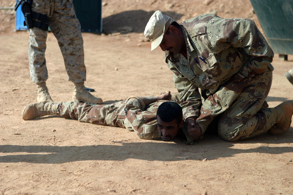 Members of the Iraqi National Guard practice search and seizure techniques they learned from U.S. Marine Corps Marines from the 3rd Light Armored Reconnaissance Battalion, 1ST Marine Division, at Camp Korean Village, a base camp near the Western Syrian-Iraq border, on Nov. 4, 2004.  The 1ST Marine Division, in support of Operation Iraqi Freedom II, is engaged in Security and Stabilization Operations (SASO) in the Al Anbar province of Iraq. (USMC PHOTO by Lance CPL. Andrew D. Young) (Released)