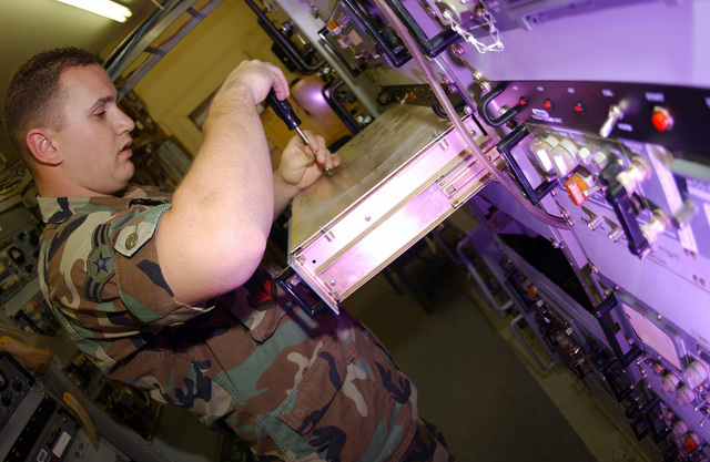 U.S Air Force AIRMAN 1ST Class Jeff Patricelli, a ground radio communications apprentice, removes a screw from a receiver during a scheduled maintenance inspection at a communications facility at Mount Lemmon, Tucson, Ariz., on Nov. 5, 2004. He is assigned to the 355th Communications Squadron at Davis-Monthan Air Force Base, Ariz. (USAF PHOTO by AIRMAN 1ST Class Christina D. Kinsey) (Released)
