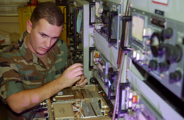 U.S Air Force AIRMAN 1ST Class Jeff Patricelli, a ground radio communications apprentice, aligns the A3 Pre-amplifier/AGC/Squelch Module in a GRR-22 Radio reciever at a communications facility at Mount Lemmon, Tucson, Ariz., on Nov. 5, 2004. He is assigned to the 355th Communications Squadron at Davis-Monthan Air Force Base, Ariz. (USAF PHOTO by AIRMAN 1ST Class Christina D. Kinsey) (Released)