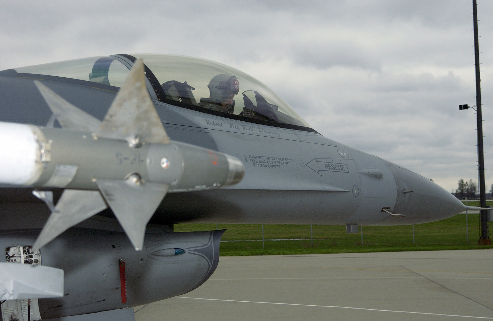 An Indiana Air National Guard F-16 Fighting Falcon aircraft taxies out for a mission during a Unit Training Assembly at the 181st Fighter Wing, Terre Haute International Airport, Ind., on Nov. 6, 2004. The aircraft is armed with an AIM-9 Sidewinder heat-seeking air-to-air missile. (USAF photo by SENIOR MASTER SGT. John S. Chapman) (RELEASED)