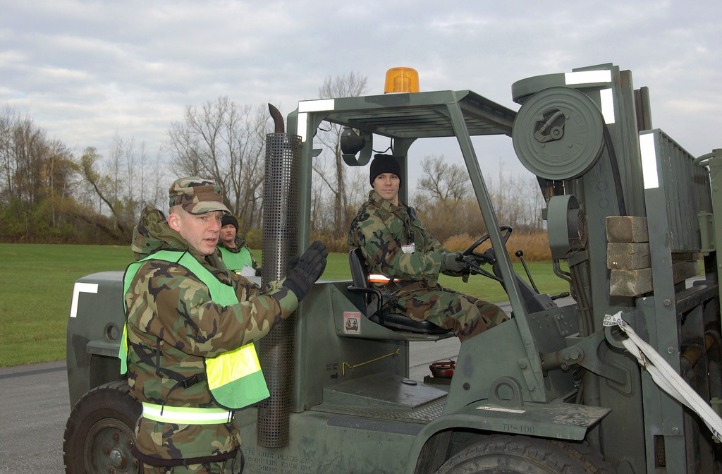 New York Air National Guard personnel uses a Hyster H155XL 15K forklift to simulate loading cargo on an aircraft during an Operational Readiness Exercise at the 174th Fighter Wing, Hancock Field Air National Guard Base, Syracuse-Hancock International Airport, N.Y., on Nov. 6, 2004. (USAF PHOTO by SENIOR AIRMAN Ricky Best) (Released)