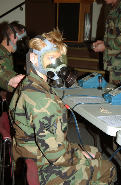 STAFF SGT. Becky Nelson, a graphics specialist, tries on her gas mask during drill weekend at Gowen Field, Boise, Idaho, on Nov. 6, 2004. She is a member of the 124th Wing, Idaho Air National Guard. (USAF PHOTO by SENIOR AIRMAN Heather Walsh) (Released)
