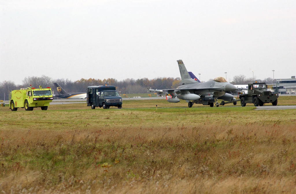 A New York Air National Guard F-16 Fighting Falcon aircraft is towed back to its hangar after an emergency landing during an Operational Readiness Exercise at the 174th Fighter Wing, Hancock Field Air National Guard Base, Syracuse-Hancock International Airport, N.Y., on Nov. 7, 2004. (USAF PHOTO by SENIOR AIRMAN Ricky Best) (Released)