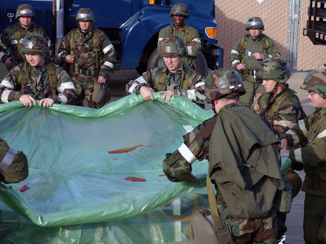 Mississippi Air National Guard members from 186th Air Refueling Wing remove a chemical contamination equipment from a cargo pallet during drill weekend at Key Field Air National Guard Base, Meridian, Miss., on Nov. 7, 2004. (USAF PHOTO by SENIOR MASTER SGT. Richard A. Davis) (Released)