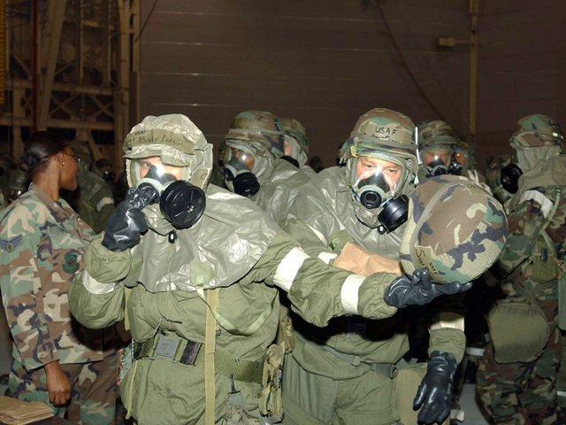 Mississippi Air National Guard members from 186th Air Refueling Wing train on the Split-Mission Oriented Protective Posture (MOPP) Concept by transitioning from MOPP Level 4 to MOPP Level 2 during drill weekend at Key Field Air National Guard Base, Meridian, Miss., on Nov. 7, 2004. (USAF PHOTO by SENIOR MASTER SGT. Richard A. Davis) (Released)