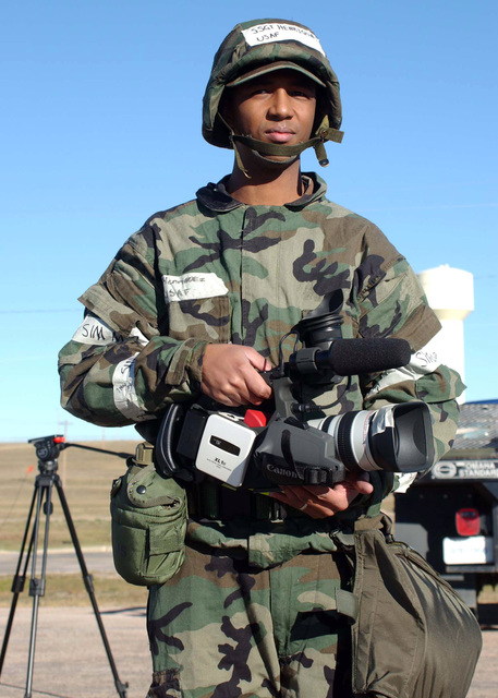 U.S. Air Force STAFF SGT. Sean Henriquez, a videographer from the 28th Commnications Squadron, prepares to document exercise Badland Express 05-02 at Ellsworth Air Force Base, S.D., on Nov. 8, 2004. (USAF PHOTO by Jamie M. Amidon) (Released)