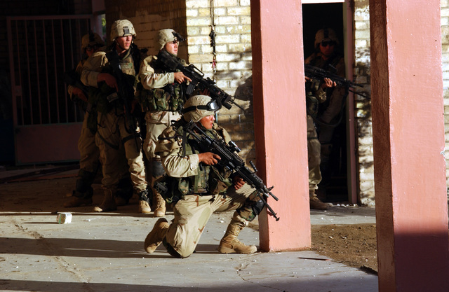 Soldiers from 1ST Platoon, Apache Troop, 2-5 Cav, 2nd BCT, 1ST Cav Div move tactically as they enter and clear their objective during combat operation in Fallujah on Nov. 9, 2004 during Operation Iraqi Freedom. (U.S. Army photo by SGT. 1ST Class Johancharles Van Boers) (Released)