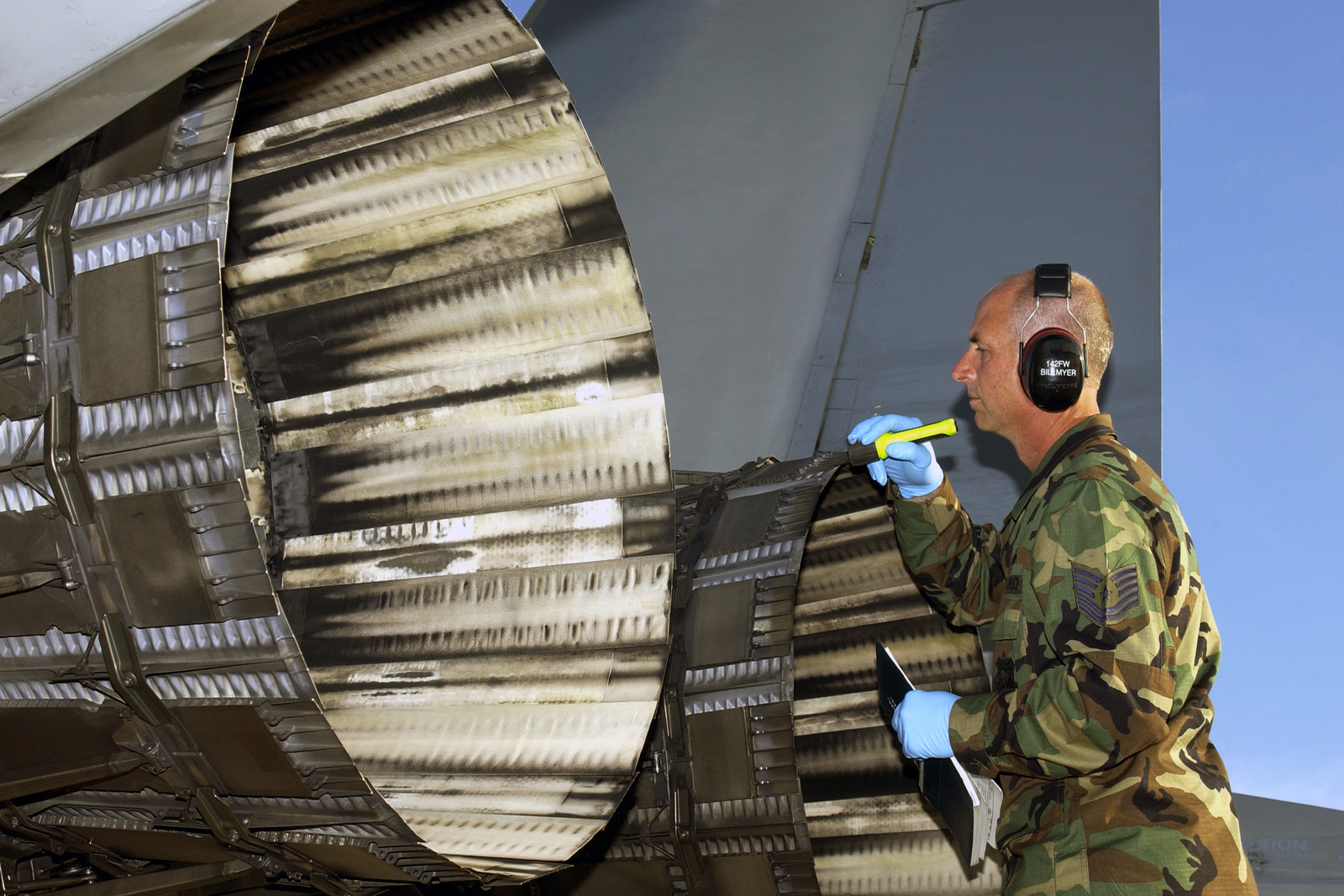 U.S. Air Force TECH. SGT. Mark Billmyer, from the 142nd Fighter Wing, Oregon Air National Guard, inspect the afterburner exhaust nozzles on an F-15 Eagle aircraft during exercise William Tell 2004 at Tyndall Air Force Base, Fla., on Nov. 9, 2004. This is the 50th Anniversary of the William Tell competition, an exercise that tests an aircrew's ability to perform under combat conditions. (USAF PHOTO by STAFF SGT. Dennis J. Henry Jr.) (Released)