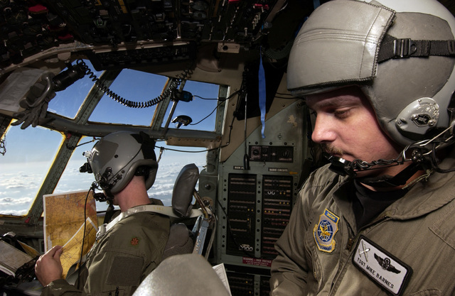 U.S. Air Force TECH. SGT. Mike Barnes, 29th Weapons Squadron, Little Rock Air Force Base, Ark., looks over a technical order while aboard a C-130 Hercules cargo aircraft during a Composite Force Operations exercise, on Nov. 9, 2004.(U.S. Air Force PHOTO by STAFF SGT. Suzanne M. Jenkins) (Released)