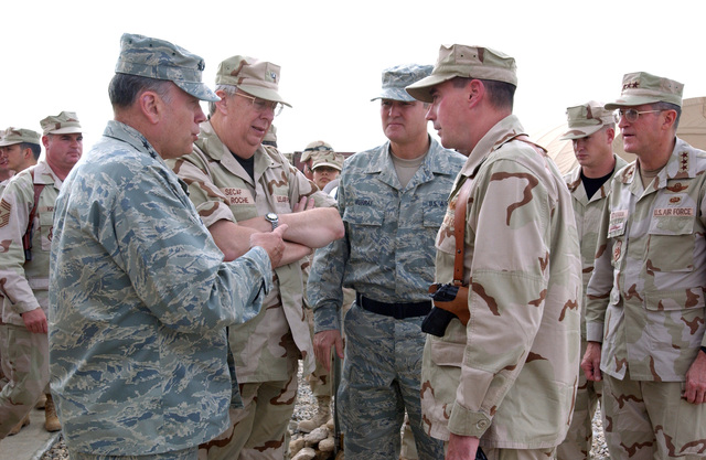 Left to right: U.S. Air Force CHIEF of STAFF GEN. John P. Jumper, Secretary of the Air Force Dr. James G. Roche, CHIEF MASTER SGT.  of the Air Force Gerald R. Murray and 407th Air Expeditionary Group Commander, COL Charles W. Johnson, discuss logistics at Tallil Air Base, Iraq, on Nov. 10, 2004, in support of Operation IRAQI FREEDOM.(U.S. Air Force PHOTO by TECH. SGT. Maria Bare) (Released)