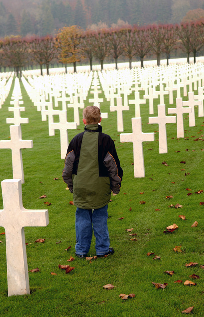 An American boy looks at the the largest American cemetery in Europe, the World War I Meuse-Argonne Cemetery and Memorial in France, during a recent Veteran's Day ceremony on Nov. 11, 2004.(U.S. Air Force PHOTO by AIRMAN 1ST Class Stacy Moless) (Released)