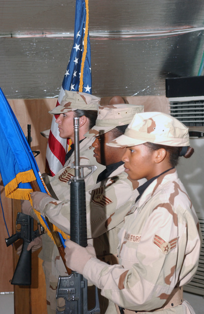 From left to right: U.S. Air Force 380th Air Expeditionary Air Wing, color guard STAFF SGT. Michelle S. Goble, MASTER SGT. Shelli A. Fisher, STAFF SGT. Bridget N. Bivens, and SrAKeyva J. Fontnette, post the colors during a Veterans Day Memorial Service at an undisclosed location, on Nov. 11, 2004, in support of Operation ENDURING FREEDOM(U.S. Air Force PHOTO by TECH. SGT. Erik Gudmundson) (Released)