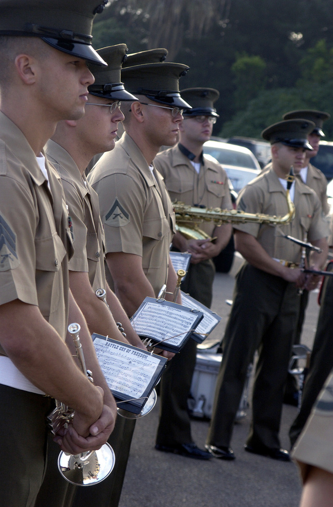 U.S. Marine Corps personnel with the Marine Band San Diego, stand at parade rest during the Friday morning colors ceremony at the Marine Corps Recruit Depot, San Diego, Calif. on Nov. 12, 2004.  (U.S. Marine Corps official photo by Lance Corporal Jared M. Padula) (Released)